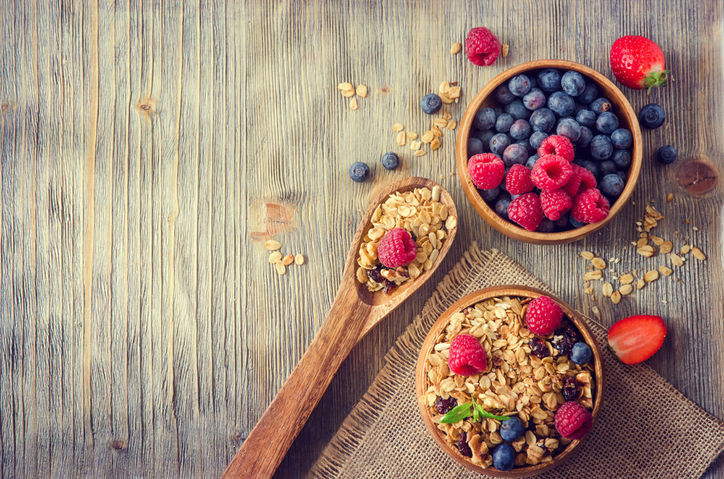 Bowls filled with granola and berries