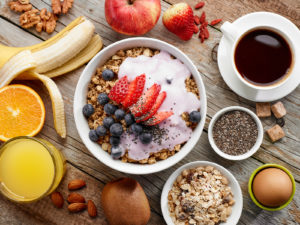 Granola, oats, yogurt and fruit with coffee